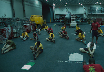 Sailors and Marines stretch  U S  Navy photo by Mass Communication Specialist Seaman Lacordrick Wilson Released