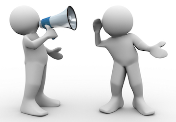 one person talking through megaphone and another listening
