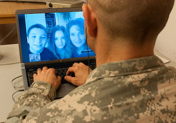 Soldier talking with family on computer screen  US Army photo