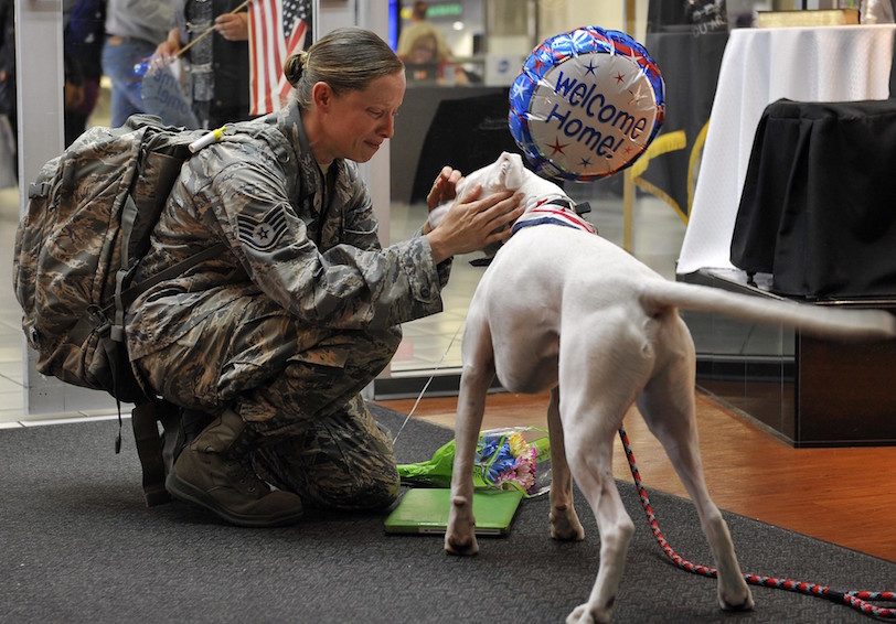 Airwoman being greeted by her dog (U.S. Air Force photo by Airman 1st Class Erica Crossen/Released)