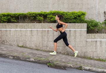 Woman running on steep hill