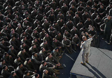 Commandant of the Marine Corps addresses Marines and Sailors (U.S. Navy photo by Mass Communication Specialist 2nd Class Jeanette Mullinax)