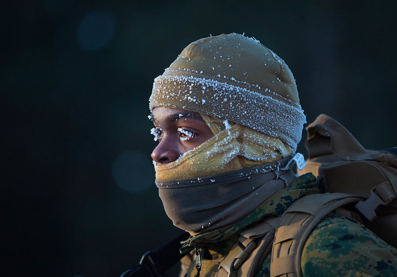Military service member in the cold. (U.S. Marine Corps photo by Lance Cpl. Cody Rowe)