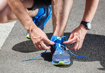 tying running shoe