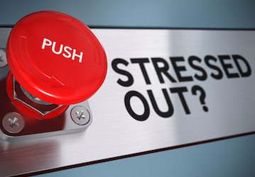"Red button with the word ""PUSH"" next to words ""STRESSED OUT?"""