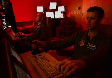 A remotely piloted aircraft crew flies a simulated training mission  U S  Air Force photo by Staff Sgt  N B  Released