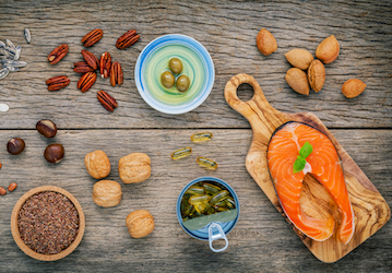 Grouping of foods high in Omega-3 such as salmon, walnuts, and flax seeds