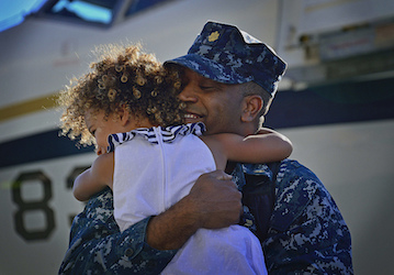 Sailor hugging his daughter (U.S. Navy photo by Mass Communication Specialist 2nd Class Daniel M. Young/Released)