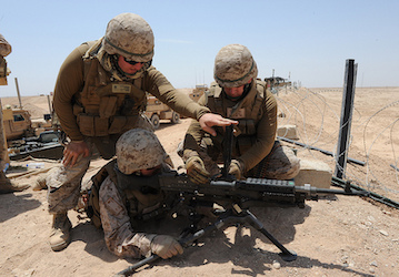 Service Member fires the M-240B machine gun. (U.S. Navy photo by Mass Communication Specialist 2nd Class Daniel Garas/Released)