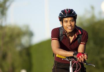 Cyclist wearing a helmet