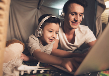 Dad and son using a computer together