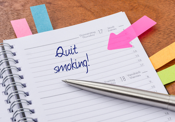 "Planner with a note that says ""Quit smoking!"""