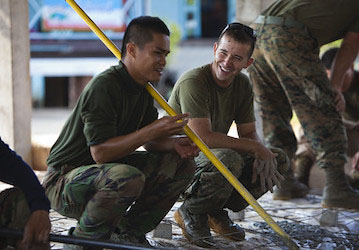 U S  Marine Corps Cpl  Alex Wisecup  right  a combat engineer with Marine Wing Support Squadron  MWSS  172  shares a laugh wi