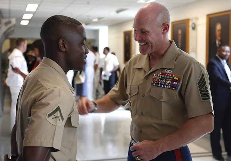 Sgt. Maj. of the Marine Corps Micheal P. Barret motivates Lance Cpl. Ethan Cadore.