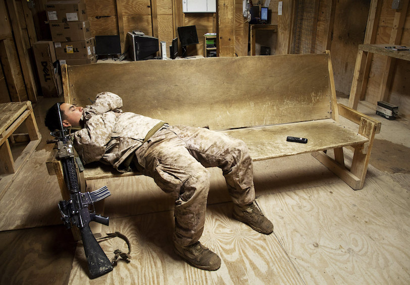 Marine taking a nap (U.S. Marine Corps photo by Cpl. Alejandro Pena)