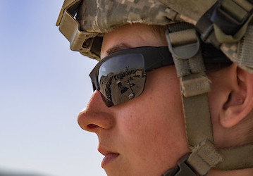 Soldier looking into the distance (Photo by Cpl. Alisha Grezlik, 115th Mobile Public Affairs Detachment)