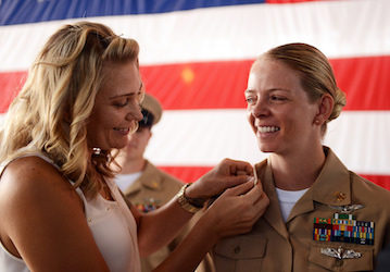 Chief Aviation Ordnanceman is pinned by her wife  U S  Navy photo by Mass Communication Specialist 2nd Class Stephanie Smith