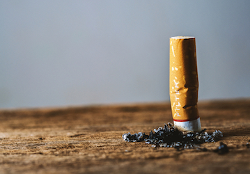 Cigarette put out on wooden surface