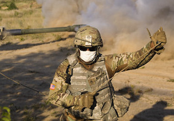 Soldier working with mask on