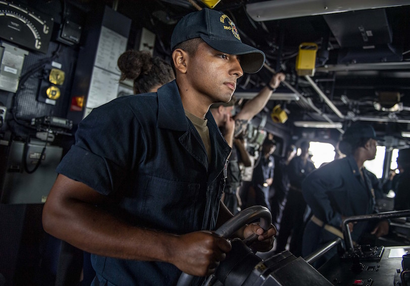 Seaman stands the helmsman watch. (U.S. Navy photo by Mass Communication Specialist 2nd Class Justin R. Pacheco/Released)