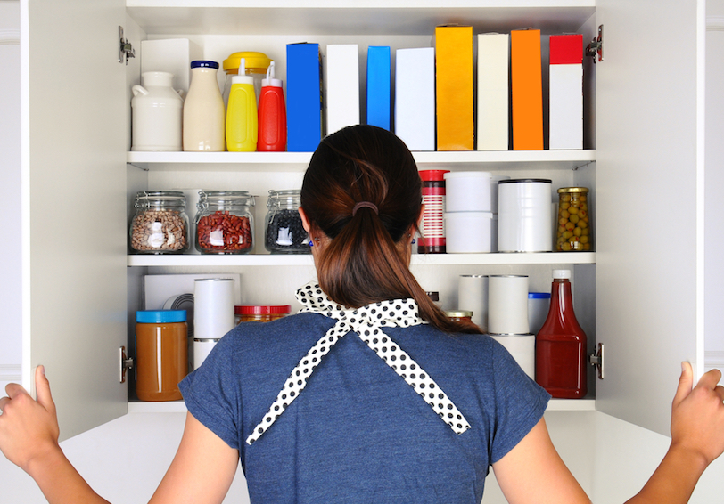 Woman looking in pantry