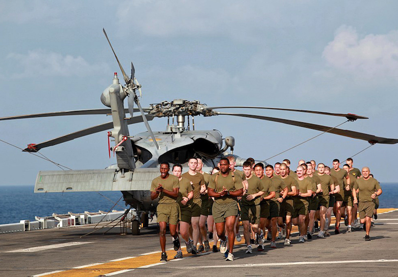 Marine and sailors complete PT run aboard USS Makin Island (U.S. Marine Corps photo by Lance Cpl. Claudia Palacios)