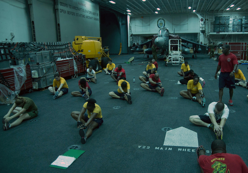Sailors and Marines stretch. U.S. Navy photo by Mass Communication Specialist Seaman Lacordrick Wilson/Released