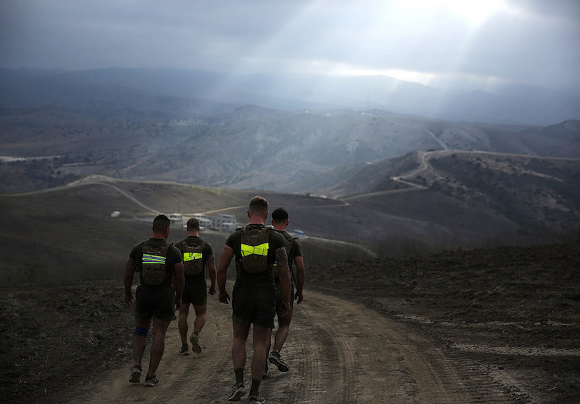 Marines run along hills. U.S. Marine Corps photo by Cpl. Will Perkins/Released