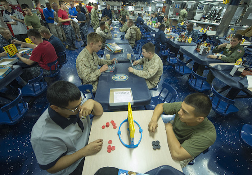 Pairs of sailors playing games in mess hall (U.S. Navy photo by Mass Communication Specialist 3rd Class Bradley J. Gee/Released)