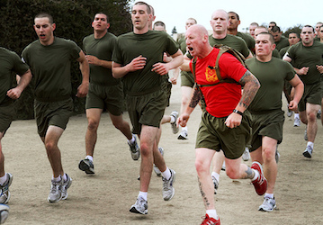 Drill instructor encourages recruits during a run (U.S. Marine Corps photos by Lance Cpl. Bridget M. Keane / Released)