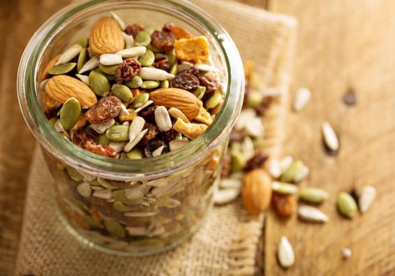 Jar filled with nuts, seeds, and dried fruit