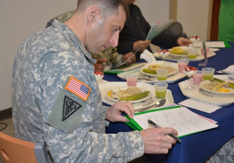 Capt. Jeremy Brooks judges food competition (Photo Credit: Ms. Ashley Patoka (Northern Regional Medical Command))