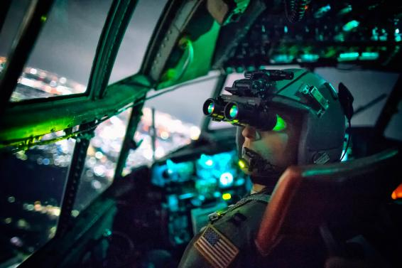 A pilot performs a visual confirmation with night vision goggles   U S  Air Force photo Osakabe Yasuo