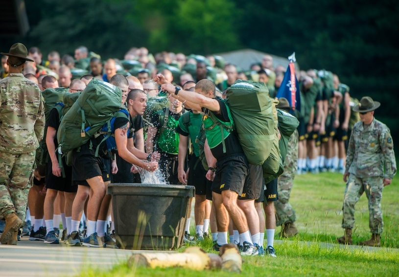 Infantrymen make use of immersion troughs filled with ice and water. (U.S. Army photo by Patrick A. Albright, Fort Benning Maneuver Center of Excellence, Fort Benning Public Affairs)