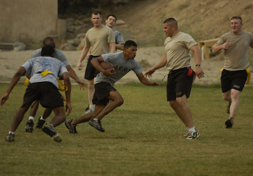 Group of soldiers in PT gear playing flag football (U.S. Army photo by Sgt. Jerry Saslav, 3BCT, 4 INF. DIV. PAO)