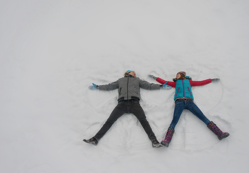 Two people making snow angels