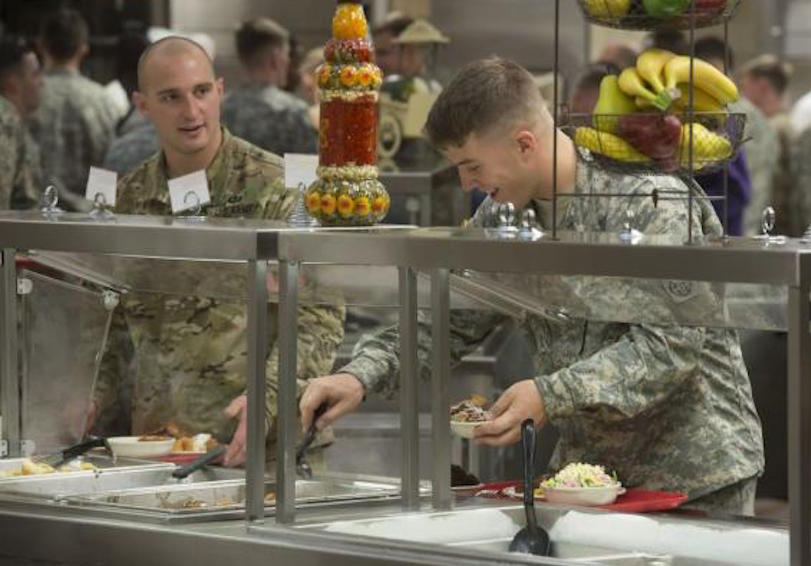 Soldiers getting food in dining hall