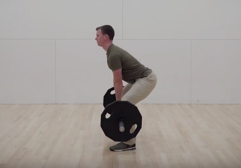 Man completing a deadlift