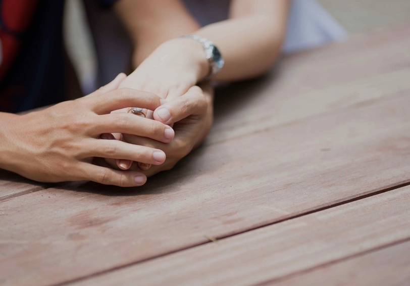 Close up of hands of couple holding hands.