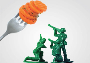 Toy soldiers pointing weapons at forkful of carrots