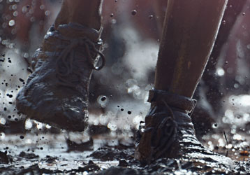 Feet running through mud