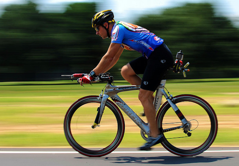 Man cycling (U.S. Air Force photo by Airman 1st Class Michael Cossaboom/Released)