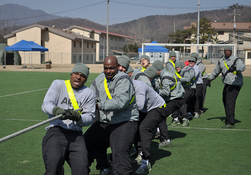 Group of soldiers in PT gear doing tug of war (US Army photo by Pfc Kim Han-byeol 210th Fires Brigade public affairs specialist)
