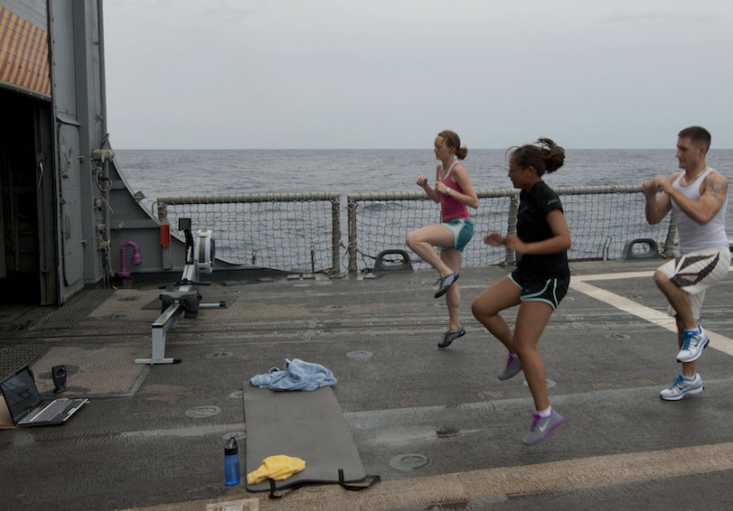 Sailors exercise on the flight deck. U.S. Navy photo by Mass Communication Specialist 2nd Class Stuart Phillips/Released.
