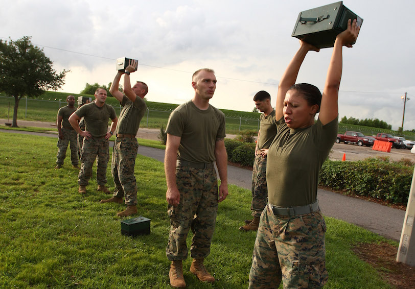 Marines lift ammo cans over their heads during a fitness test (DoD photo by Lance Cpl. Abby Burtner, U.S. Marine Corps/Released)