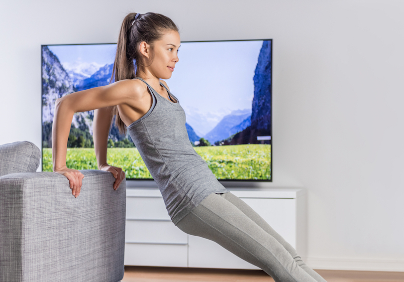 Person working out in her living room