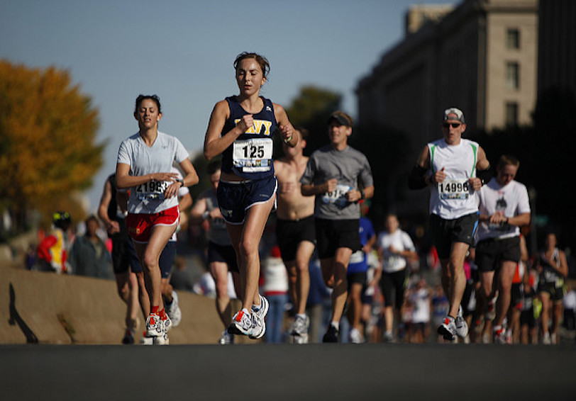People running a road race (Official Marine Corps photo by Cpl. Scott Schmidt/Released)
