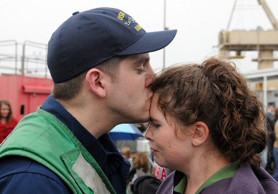 Sailor kisses his wife  (U.S. Navy photo by Chief Mass Communication Specialist Ahron Arendes/Released)