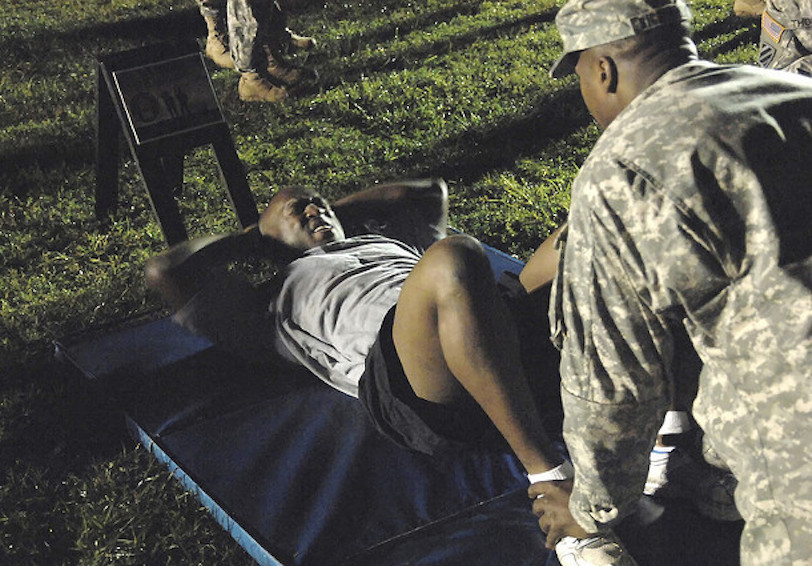 Soldier completing sit-ups. Photo by Mike Strasser.