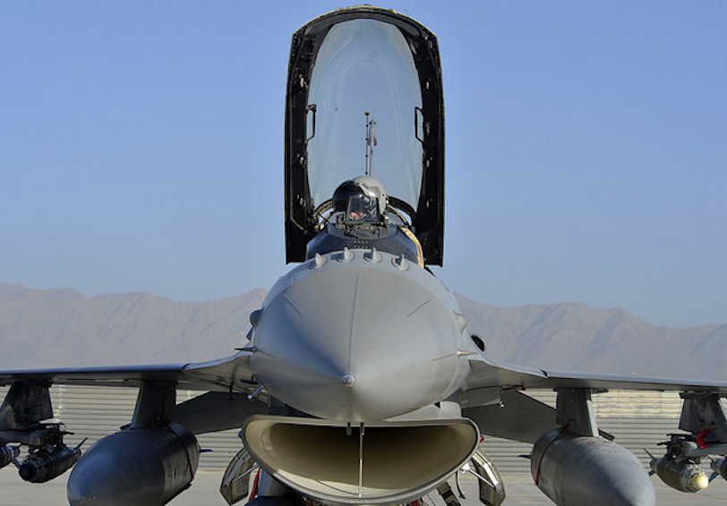 F-16 Fighting Falcon and pilot preparing for flight (U.S. Air Force photo by Staff Sgt. Evelyn Chavez/Released)